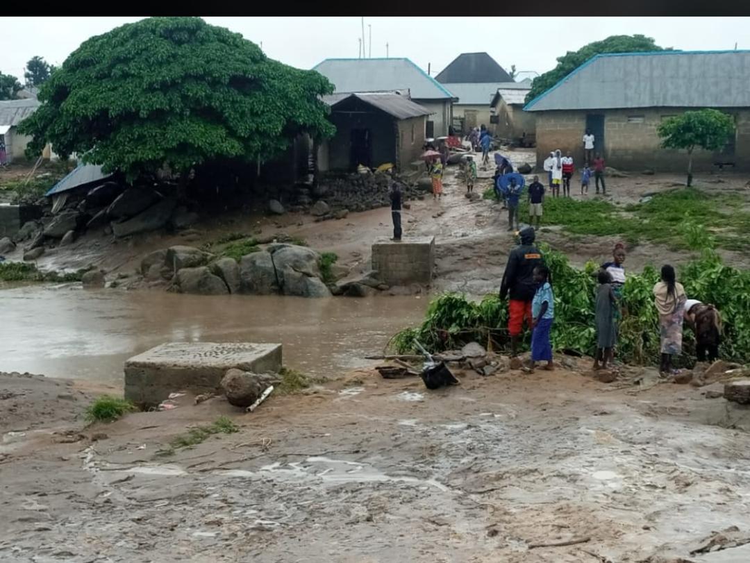 People look helplessly as flood rages on