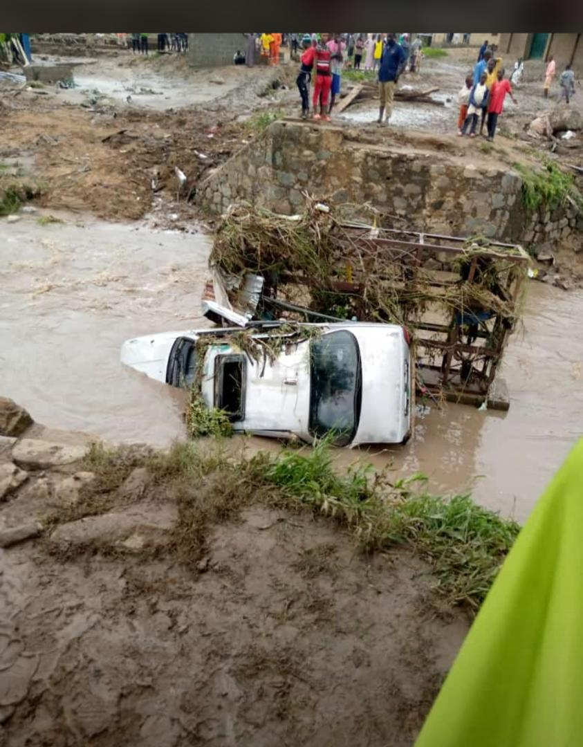 Car destroyed by the flood at Giri, Abuja yesterday